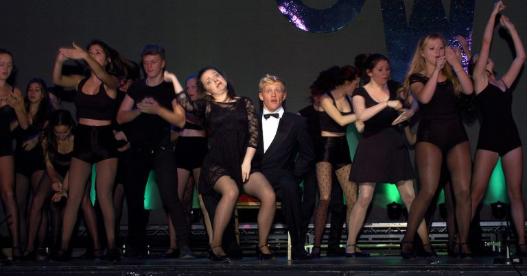 Photo of cast performing Chicago section
