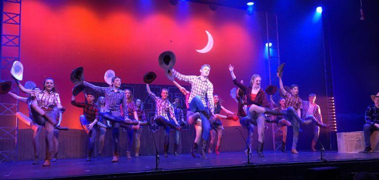 Performing line dance in Footloose